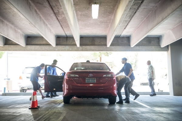 Inspectors from Tire Kickers look over Uber car candidates at the Hampton Inn in Las Vegas on Thursday, Sept. 3, 2015. Tire Kickers expects to see around 400 and 600 cars per day, evaluating the f ...