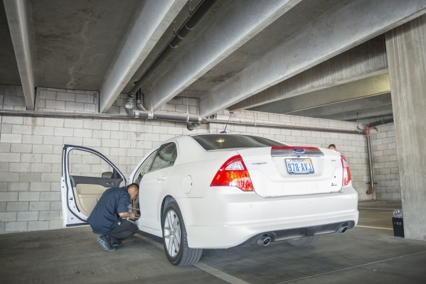 Kenneth Angeles from Tire Kickers looks at Uber car candidates at the Hampton Inn in Las Vegas on Thursday, Sept. 3, 2015. Tire Kickers expects to see around 400 and 600 cars per day, evaluating t ...
