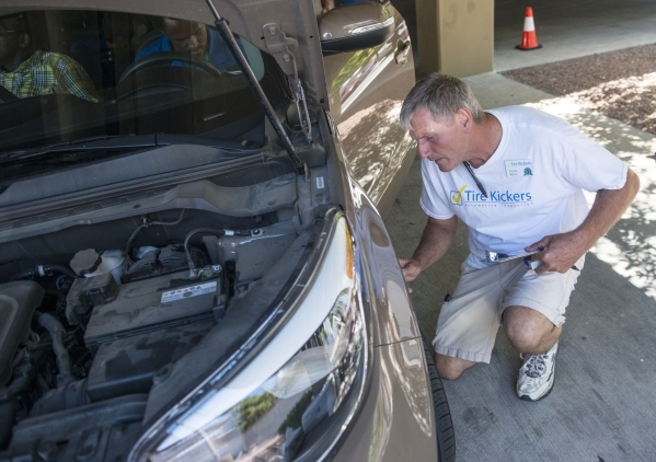 Duane Moore, owner of Tire Kickers, looks over Uber car candidates at the Hampton Inn in Las Vegas on Thursday, Sept. 3, 2015. Tire Kickers expects to see around 400 and 600 cars per day, evaluati ...