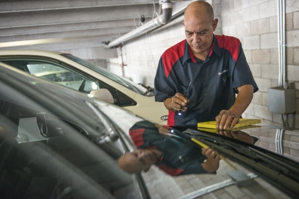 Milton Poole, team leader at Tire Kickers, looks at Uber car candidates at the Hampton Inn in Las Vegas on Thursday, Sept. 3, 2015. Tire Kickers expects to see around 400 and 600 cars per day, eva ...