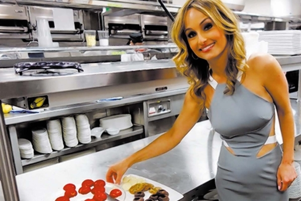 Giada De Laurentiis takes a cookie break during the VIP party June 2, 2014, at her first restaurant, Giada, at The Cromwell. The restaurant was not mentioned in a TMZ report about the terms of her ...