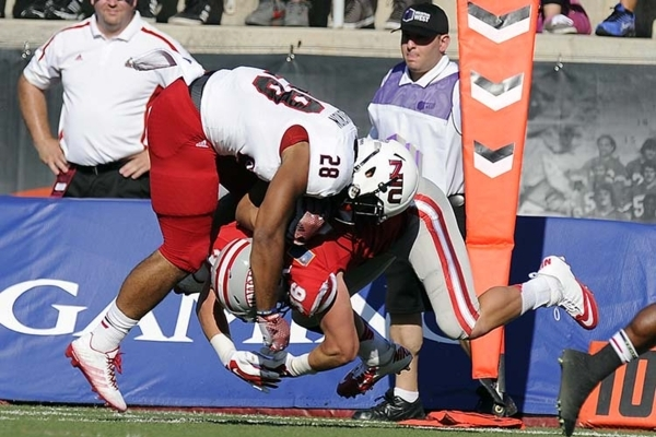 UNLV linebacker Marc Philppi (36) tackles Northern Illinois tailback Joel Bouagnon (28) during the first half of the Huskies' 48-34 win over the Rebels on Sept. 13, 2014, at Sam Boyd Stadium ...