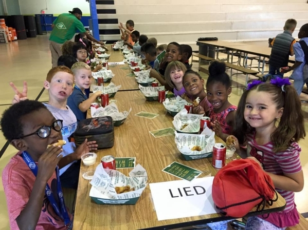 Children enjoy a free chicken wing lunch Aug. 18 at  the Boys & Girls Clubs of Southern Nevada's Lied Memorial Clubhouse, 2850 Lindell Road. The event helped celebrate the Wingstop Flavo ...