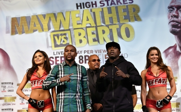 Boxers Floyd Mayweather Jr., second left, and Andre Berto pose after their final news conference at MGM Grand hotel-casino in Las Vegas on Wednesday, Sept. 9, 2015. The two are scheduled to fight  ...