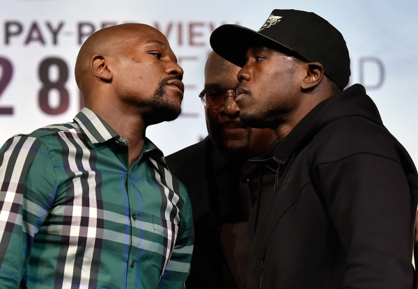 Boxers Floyd Mayweather Jr., left, and Andre Berto face off after their final news conference at MGM Grand hotel-casino in Las Vegas on Wednesday, Sept. 9, 2015. The two are scheduled to fight at  ...