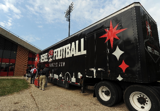 UNLV equipment managers are seen hauling equipment into the lockerroom before the start of their NCAA Football game between the UNLV Rebels and the Northern Illinois Huskies at Huskie Stadium in D ...