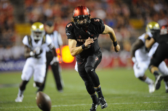 UNLV Rebels quarterback Blake Decker (5) chases after a high snap against the UCLA Bruins in the first quarter at Sam Boyd Stadium Saturday, Sept. 12 2015. Josh Holmberg/Las Vegas Review-Journal