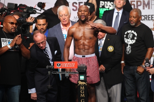 Boxer Floyd Mayweather Jr. weigh-ins ahead of his Sept. 12 fight against Andre Berto at the MGM Grand Garden Arena in Las Vegas on Friday, Sept. 11, 2015. Chase Stevens/Las Vegas Review-Journal Fo ...