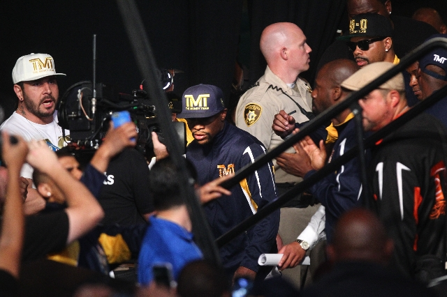 Boxer Floyd Mayweather Jr. makes his way to the stage for the weigh-in event ahead of his Sept. 12 fight against Andre Berto at the MGM Grand Garden Arena in Las Vegas on Friday, Sept. 11, 2015. C ...