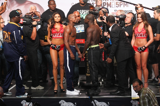 Boxers Floyd Mayweather Jr., left, and Andre Berto pose for a photo ahead of their Sept. 12 fight during the weigh-in event at the MGM Grand Garden Arena in Las Vegas on Friday, Sept. 11, 2015. Ch ...