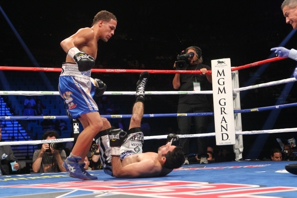 Jonathan Oquendo knocks Jhonny Gonzalez down near the end of the second round of their super featherweight bout at the MGM Grand Garden Arena Saturday, Sept. 12, 2015. Chase Stevens/Las Vegas Revi ...
