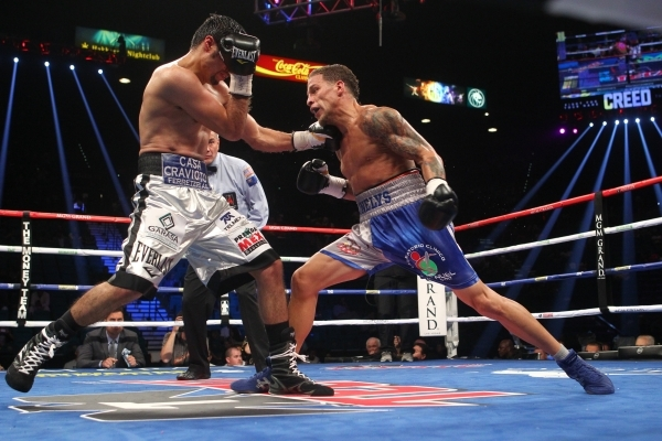 Jhonny Gonzalez, left, connects a left against Jonathan Oquendo during their super featherweight boxing match at the MGM Grand Garden Arena in Las Vegas on Saturday, Sept. 12, 2015. Chase Stevens/ ...