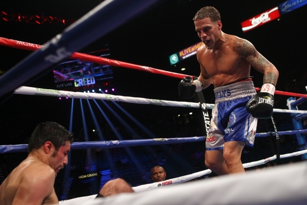 Jhonny Gonzalez, left, is knocked down by Jonathan Oquendo during their super featherweight boxing match at the MGM Grand Garden Arena in Las Vegas on Saturday, Sept. 12, 2015. Chase Stevens/Las V ...