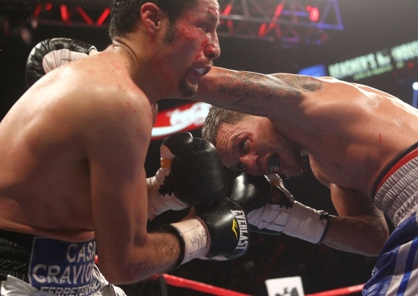 Jonathan Oquendo, right, connects with Jhonny Gonzalez during their super featherweight boxing match at the MGM Grand Garden Arena in Las Vegas on Saturday, Sept. 12, 2015. Chase Stevens/Las Vegas ...