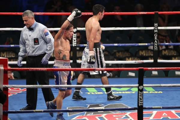 Jonathan Oquendo, left, reacts after his super feather weight bout against Jhonny Gonzalez at MGM Grand Garden Arena in Las Vegas Saturday, Sept. 12, 2015. Oquendo won by a split decision. Erik Ve ...