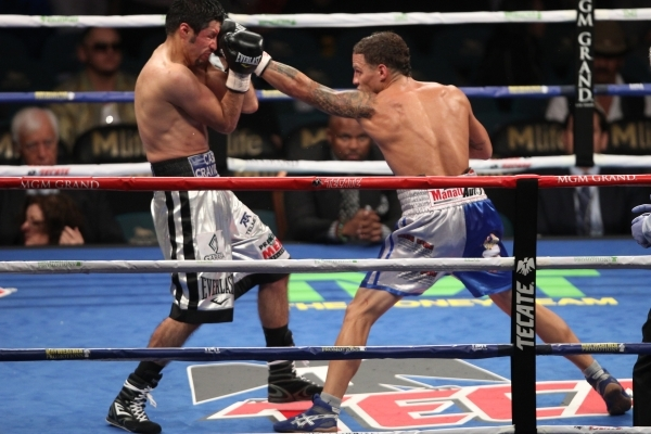 Jonathan Oquendo, right, connects a punch against Jhonny Gonzalez in their super feather weight bout at MGM Grand Garden Arena in Las Vegas Saturday, Sept. 12, 2015. Oquendo won by a split decisio ...