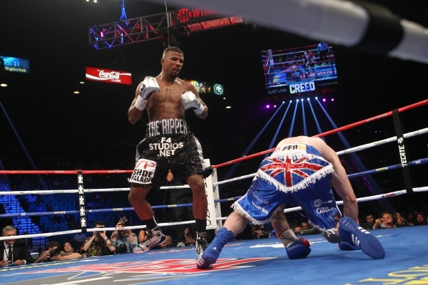 Badou Jack, left, knocks down George Groves during their super middleweight title boxing match at the MGM Grand Garden Arena in Las Vegas on Saturday, Sept. 12, 2015. Jack won by split decision. C ...