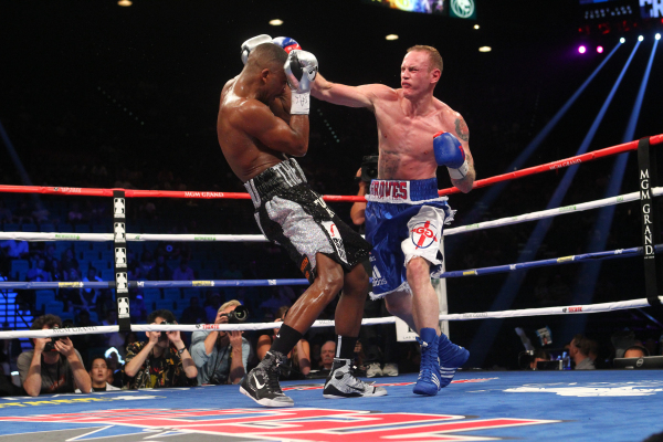 George Groves, right, connects with Badou Jack during their super middleweight title boxing match at the MGM Grand Garden Arena in Las Vegas on Saturday, Sept. 12, 2015. Jack won by split decision ...
