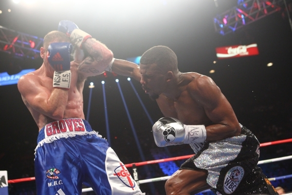 Badou Jack, right, connects with George Groves during their super middleweight title boxing match at the MGM Grand Garden Arena in Las Vegas on Saturday, Sept. 12, 2015. Jack won by split decision ...