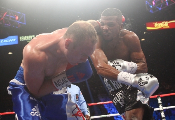 Badou Jack, right, hits George Groves during their super middleweight title boxing match at the MGM Grand Garden Arena in Las Vegas on Saturday, Sept. 12, 2015. Jack won by split decision. Chase S ...