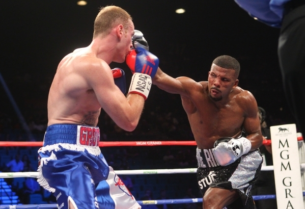 Badou Jack, right, connects with a right against George Groves during their super middleweight title boxing match at the MGM Grand Garden Arena in Las Vegas on Saturday, Sept. 12, 2015. Jack won b ...