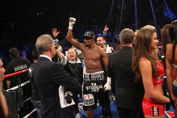 Badou Jack reacts after defeating George Groves during their super middleweight title boxing match at the MGM Grand Garden Arena in Las Vegas on Saturday, Sept. 12, 2015. Jack won by split decisio ...