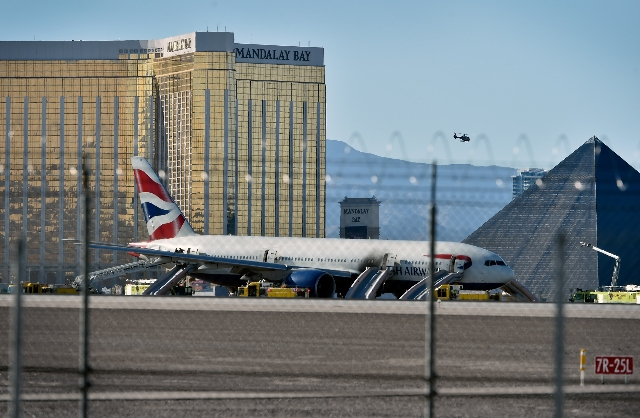 A British Airways passenger jet is park on the runways after a fire at McCarran International Airport on Tuesday, Sept. 8, 2015. The Boeing 777-200 was headed to Gatwick Airport in London on fligh ...