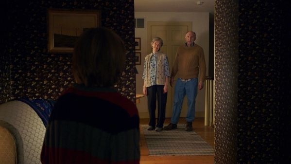 "(L to R) Tyler (ED OXENBOULD) is terrified by Nana (DEANNA DUNAGAN) and Pop Pop (PETER MCROBBIE) in Universal Pictures' ""The Visit"". Writer/Director/ Producer M. Night Shyamalan re ..."