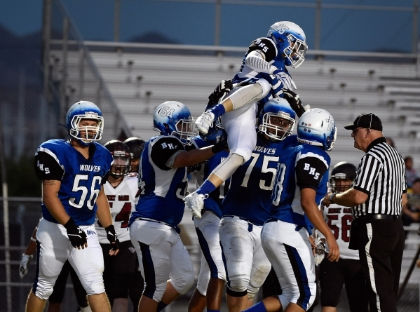 Basic's Jake Waldren (25) celebrates with his teammates after scoring a touchdown against Desert Oasis during the first half of a high school football game at Basic High School Friday, Sept. ...