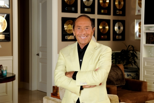 Singer and songwriter Paul Anka -- who makes his Smith Center debut Friday -- poses with some of the gold records he's earned during more than 50 years in music. Courtesy Paul Anka Productions.