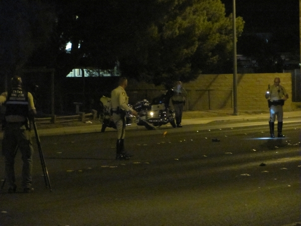 Las Vegas police work at the scene of an auto-pedestrian accident on East Lake Mead Boulevard, between Linn Lane and Sloan Lane, in the northeast valley on Thursday, Sept. 10, 2015. Lake Mead was  ...