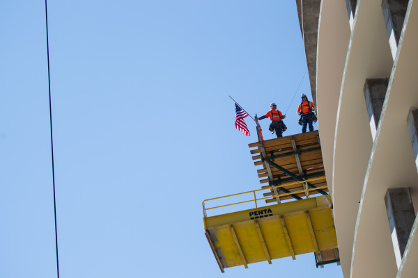 "Construction workers prepare to receive the ceremonial tree during the ""topping off"" ceremony at the Lucky Dragon hotel-casino in Las Vegas on Friday, Sept. 11, 2015. Chase Stevens/Las V ..."