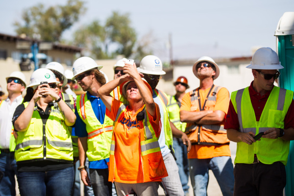 "Construction workers watch the ""topping off"" ceremony at the Lucky Dragon hotel-casino in Las Vegas on Friday, Sept. 11, 2015. Chase Stevens/Las Vegas Review-Journal Follow @csstevensphoto"