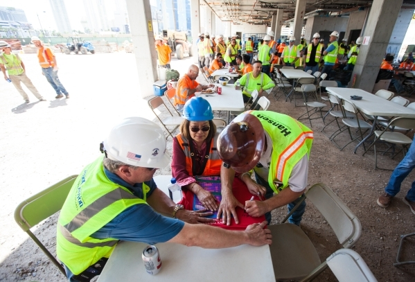 "Lin Huang gets a t-shirt signed following the ""topping off"" ceremony at the Lucky Dragon hotel-casino in Las Vegas on Friday, Sept. 11, 2015. Chase Stevens/Las Vegas Review-Journal Follo ..."