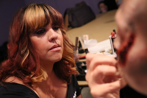 Rebecca Morgan, lead makeup artist for the Fright Dome production at Circus Circus, paints the face of Las Vegas Review Journal reporter Michael Lyle at Circus Circus in Las Vegas Sunday, Sept. 13 ...