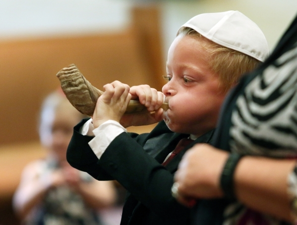 Adam Underwood, 7, practices blowing the shofar during a Rosh Hashanah preschool family service at Congregation Ner Tamid Monday, Sept. 14, 2015, in Henderson. Rosh Hashanah, the Jewish New Year,  ...