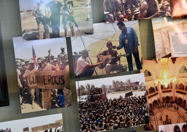 Photographs from Wayne Newton's trips with the USO visiting troops overseas is seen in a display case at the museum at Casa de Shenandoah on Monday, Sept. 14, 2015, in Las Vegas. The ranch a ...
