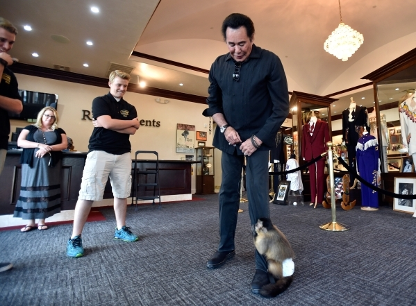 Wayne Newton and his pet capuchin monkey, Boo, spend a little time together while Newton tours the museum at Casa de Shenandoah on Monday, Sept. 14, 2015, in Las Vegas. The ranch at Sunset and Pec ...