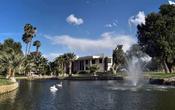 Two swans grace one of the lakes in front of the main house at Casa de Shenandoah on Monday, Sept. 14, 2015, in Las Vegas.  The ranch at Sunset and Pecos roads in Las Vegas is scheduled to open fo ...