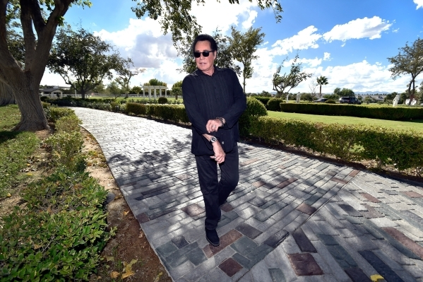 Entertainer Wayne Newton walks along a pathway at Casa de Shenandoah on Monday, Sept. 14, 2015, in Las Vegas. The ranch at Sunset and Pecos roads in Las Vegas is scheduled to open for public tours ...