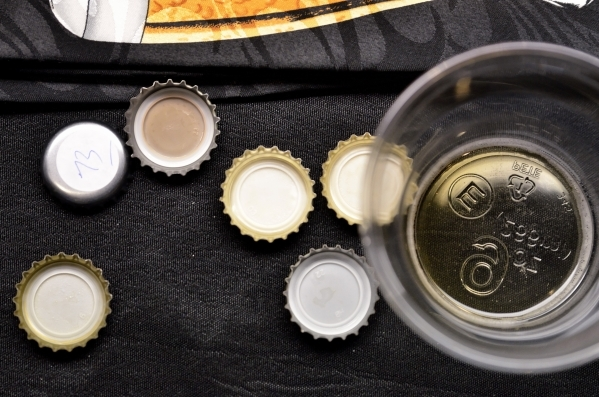 Bottle caps from beers being tested during a blind tasting are shown at the Southern Nevada Ale Fermenting Union at Aces and Ales at 3740 S. Nellis Blvd. in Las Vegas on Friday, Sept. 11, 2015. Bi ...