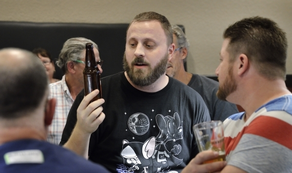 Drew Holm discusses a beer he sampled during a meeting of the Southern Nevada Ale Fermenting Union at Aces and Ales at 3740 S. Nellis Blvd. in Las Vegas on Friday, Sept. 11, 2015. Bill Hughes/Las  ...