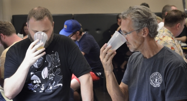 Drew Holm, left, and Jeff Witt sample a beer during a meeting at the Southern Nevada Ale Fermenting Union at Aces and Ales at 3740 S. Nellis Blvd. in Las Vegas on Friday, Sept. 11, 2015. Bill Hugh ...