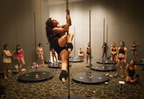 Instructor Zorany Judd demonstrates a  move during static pole dancing workshop at Pole Expo 2015 inside the Hard Rock Hotel & Casino, 4455 Paradise Road,  on Friday, Sept. 11,2015. Nearly 2,0 ...