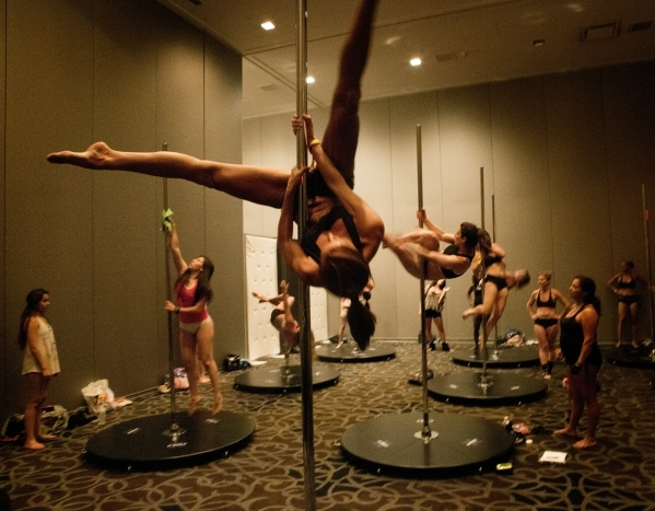 Tonya Guadiz of Dallas tries a move during static pole dancing workshop at Pole Expo 2015 inside the Hard Rock Hotel & Casino, 4455 Paradise Road,  on Friday, Sept. 11,2015. Nearly 2,000 peopl ...