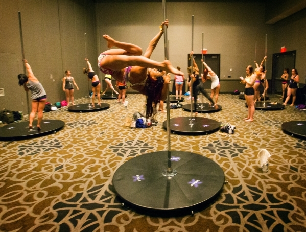 Sharmaine Figuerao of Puerto Rico tries a move during a spinning tricks and combo workshop during Pole Expo 2015 inside the Hard Rock Hotel & Casino, 4455 Paradise Road,  on Friday, Sept. 11,2 ...
