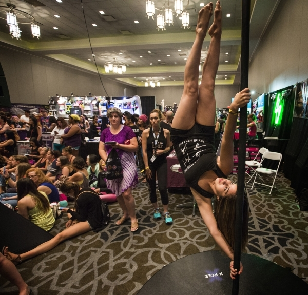 Michell Garza of San Antonio performs on a pole during Pole Expo 2015 inside the Hard Rock Hotel & Casino, 4455 Paradise Road,  on Friday, Sept. 11,2015. Nearly 2,000 people are attending the  ...