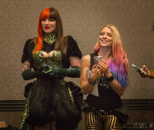 Burlesque performer Kassy Luvjoy,left, and  Fawnia Dietrich  watches burlesque dancer Mone't perform during the  Pole Expo 2015 inside the Hard Rock Hotel & Casino, 4455 Paradise Road,   ...