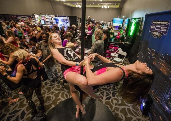 Hanna Khatib,left, and Claire Nachowicz both from Chicago perform on a pole during Pole Expo 2015 inside the Hard Rock Hotel & Casino, 4455 Paradise Road,  on Friday, Sept. 11,2015. Nearly 2,0 ...