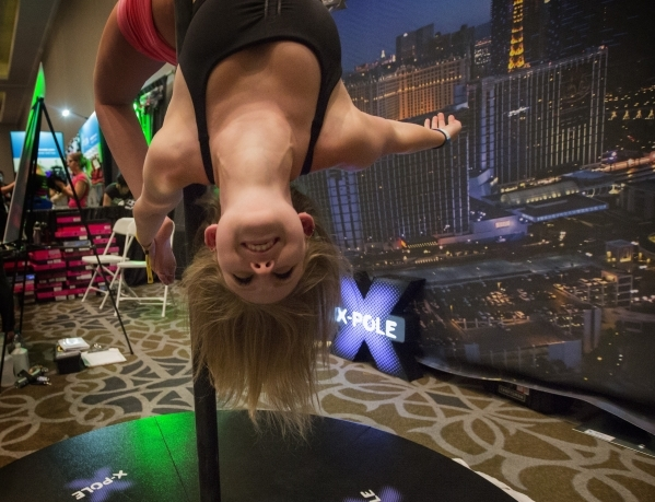 Hanna Khatib of Chicago performs on a pole during Pole Expo 2015 inside the Hard Rock Hotel & Casino, 4455 Paradise Road,  on Friday, Sept. 11,2015. Nearly 2,000 people are attending the four  ...